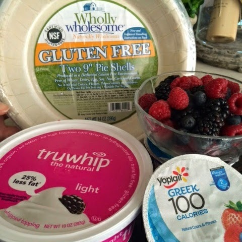 2 containers (6 oz. each) Yoplait Greek 100 calorie yogurt Mixed Berry 1 Wholly Wholesome GF pie crust or GF Graham Cracker Crust